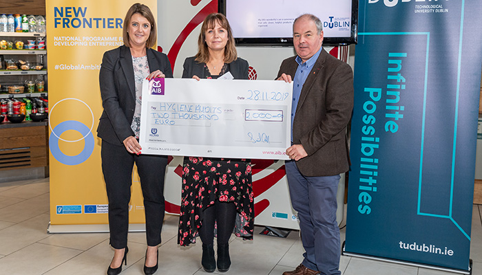AIB Supporting Start-up Award winner Glenda Hahn (Hygiene Audits) recieves a cheque for €2000 from AIB representative and David McDonnell (Synergy Manager) at the 2019 New Frontiers Phase 2 Showcase Event in the Synergy Centre at TU Dublin.